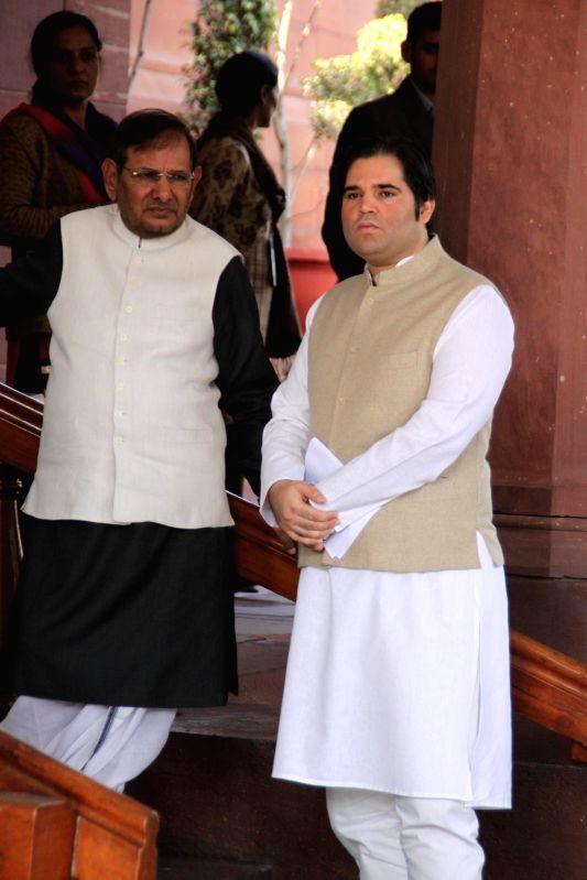 JD (U) chief Sharad Yadav and BJP MP Varun Gandhi at the Parliament premises in New Delhi, on Dec 1, 2014. - Sharad Yadav and Varun Gandhi