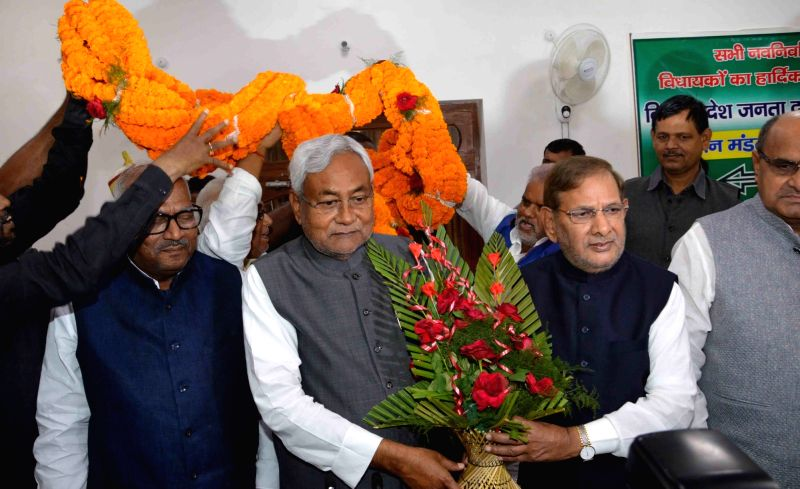 JD (U) chief Sharad Yadav and Nitish Kumar during a party programme in Patna, on Nov 14, 2015.