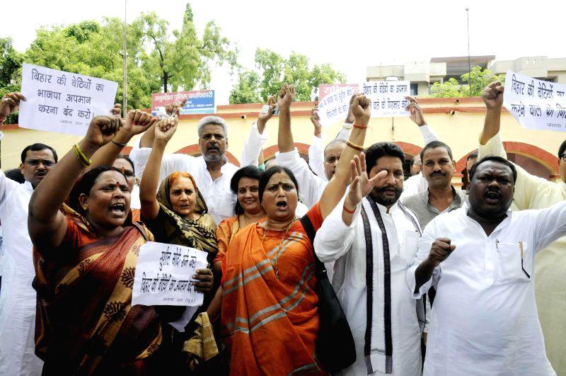 JD(U) legislators demonstrate against BJP's National Kisan Morcha president, OP Dhankar's remarks on Bihari women at in Patna on July 8, 2014.