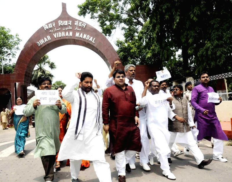 JD(U) legislators demonstrate against the remark of BJP's National Kisan Morcha president, OP Dhankar on Bihari women at in Patna on July 8, 2014.