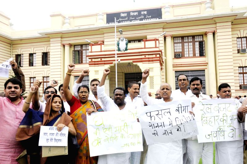 JD(U) legislators demonstrate against the remark of BJP's National Kisan Morcha president, OP Dhankar on Bihari women at Bihar Legislative Assembly in Patna on July 10, 2014.