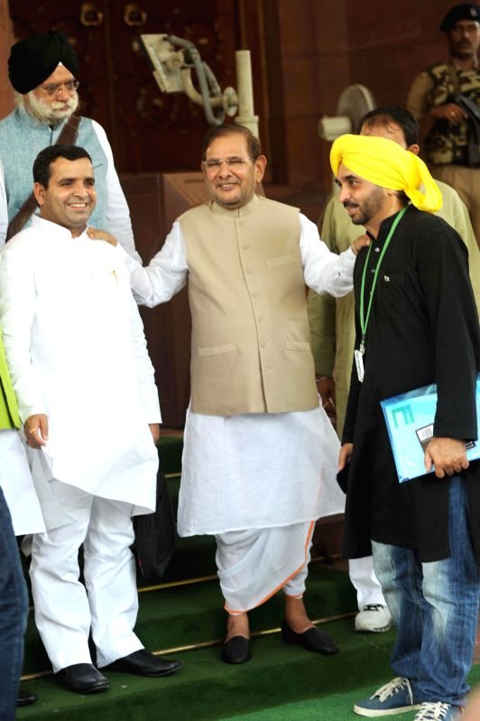 JD(U) MP Sharad Yadav with Samajwadi Party MP Dharmendra Yadav and Aam Aadmi Party (AAP) MP Bhagwant Mann at the Parliament House on August 01,2014. - Sharad Yadav and Dharmendra Yadav