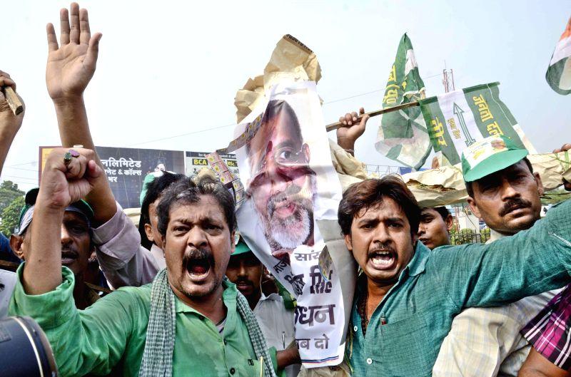 JD(U) workers demonstrate against Giriraj Singh in Patna on July 9, 2014.