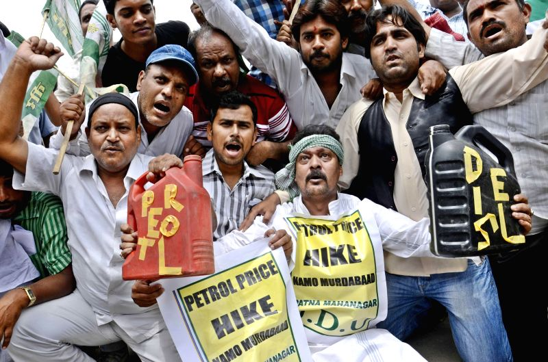 JD(U) workers demonstrate against hike in fuel prices in Patna on July 1, 2014.