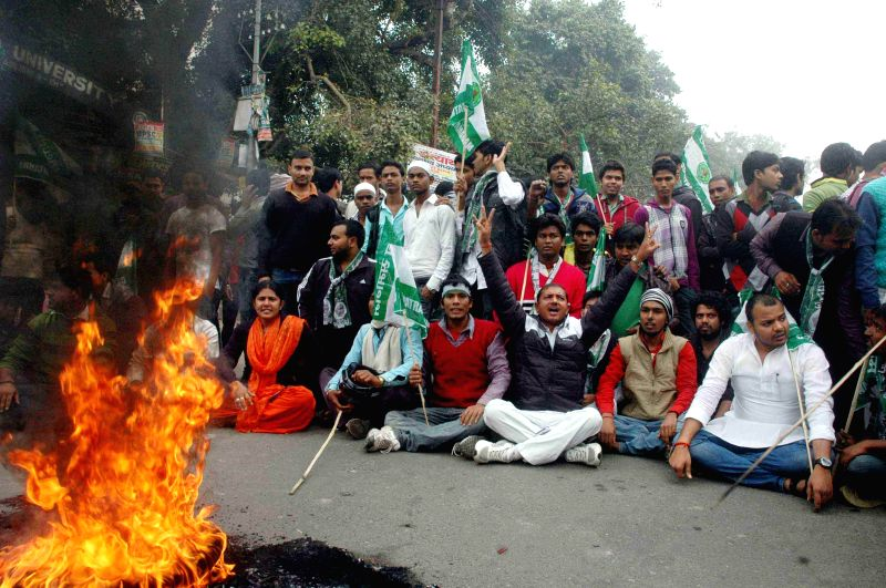 JD(U) workers stage a demonstration against beating-up of party's student leader by police in Arrah of Bihar,  in Patna, on Dec 4, 2014.
