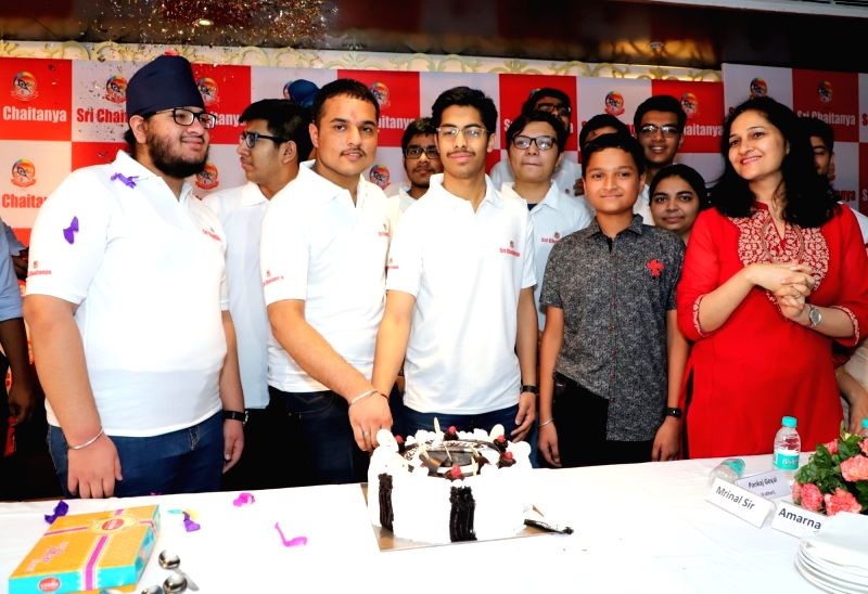 JEE-Advanced 2018 topper Pranav Goyal celebrates his achievement with family in Chandigarh, on June 10, 2018.