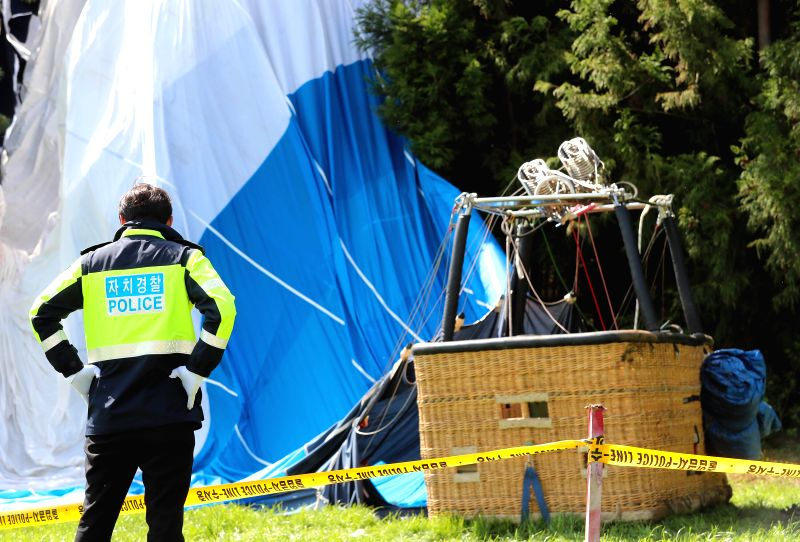 JEJU, April 12, 2018 - A policeman works at the site of a hot air balloon crash in the island of Jeju, South Korea, April 12, 2018. One person was killed and 12 others injured in a hot air balloon ...
