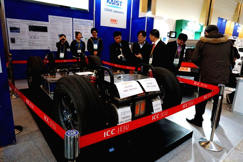 People visit the booth of Korea Advanced Institute of Science and Technology during the International Electric Vehicle Expo (IEVE) in Jeju island of South Korea, on ...