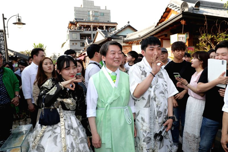 JEONJU, May 3, 2017 - Ahn Cheol-soo (C), presidential candidate of People's Party, attends a campaign at a traditional Hanok village in Jeonju, South Korea, May 3, 2017. A presidential by-election is ...