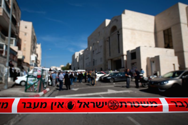 A security perimeter is seen at the scene near a synagogue in west Jerusalem on Nov. 18, 2014. Four Israelis were killed and eight injured in a militant attack at a synagogue in west ...