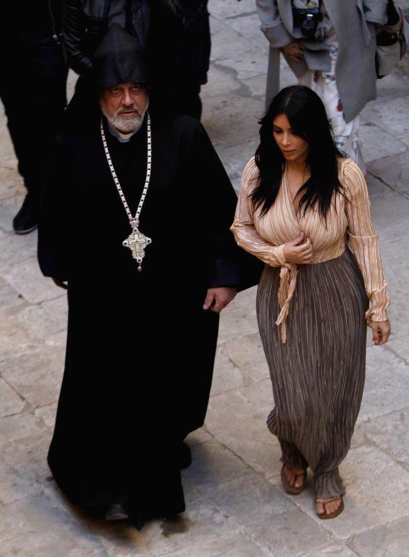 U.S. reality TV star Kim Kardashian (R) walks with a clergy at the Armenian Patriarchate of Jerusalem in the Old City of Jerusalem, on April 13, 2015. U.S. ...