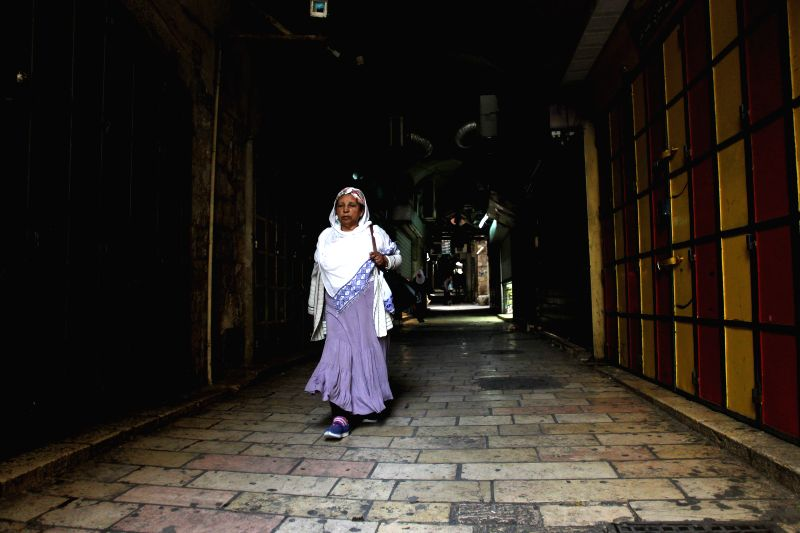 JERUSALEM, April 27, 2017 - People walk past closed shops in Jerusalem's Old City, on April 27, 2017. Palestinians across the West Bank and East Jerusalem took part in a trade strike to support the ...