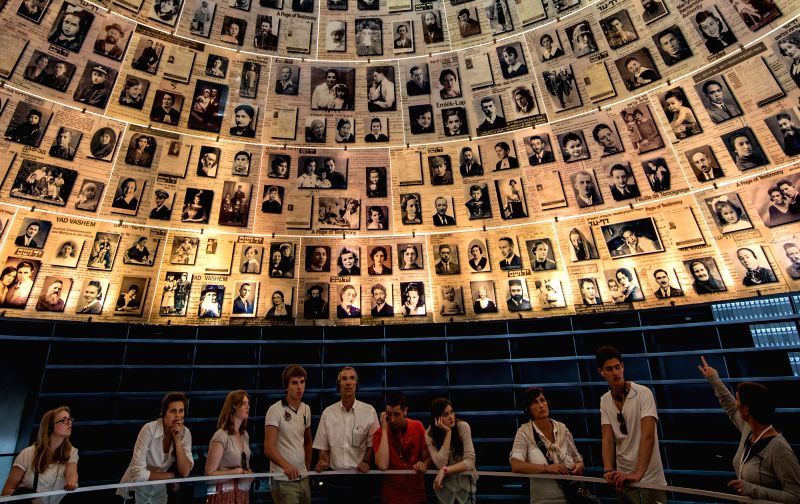 People visit the Hall of Names of the Yad Vahsem Holocaust memorial museum in Jerusalem, on April 28, 2014. From Sunday evening to Monday, Israel officially ...