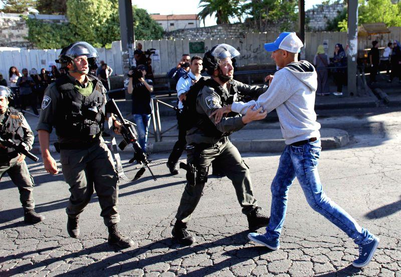 JERUSALEM, April 29, 2017 - A supporter of Palestinians imprisoned in Israeli jails clashes with Israeli police in Jerusalem, on April 29, 2017.