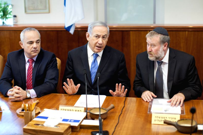 Israeli Prime Minister Benjamin Netanyahu (C) addresses the weekly cabinet meeting at Prime Minister's office in Jerusalem, on Aug. 17, 2014. Israeli Prime ...