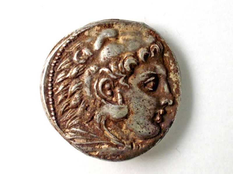 Handout photo released on Dec. 15, 2014, shows the head of Heracles on a rare coin from the Hellenistic period discovered recently in the excavations of a ...