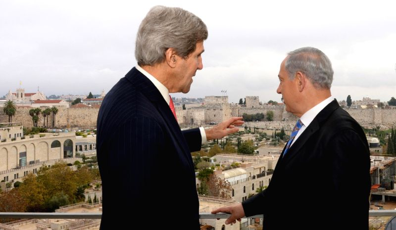 JERUSALEM, Dec. 6, 2013 (Xinhua/IANS)Visiting U.S. Secretary of State John Kerry (L) talks with ...