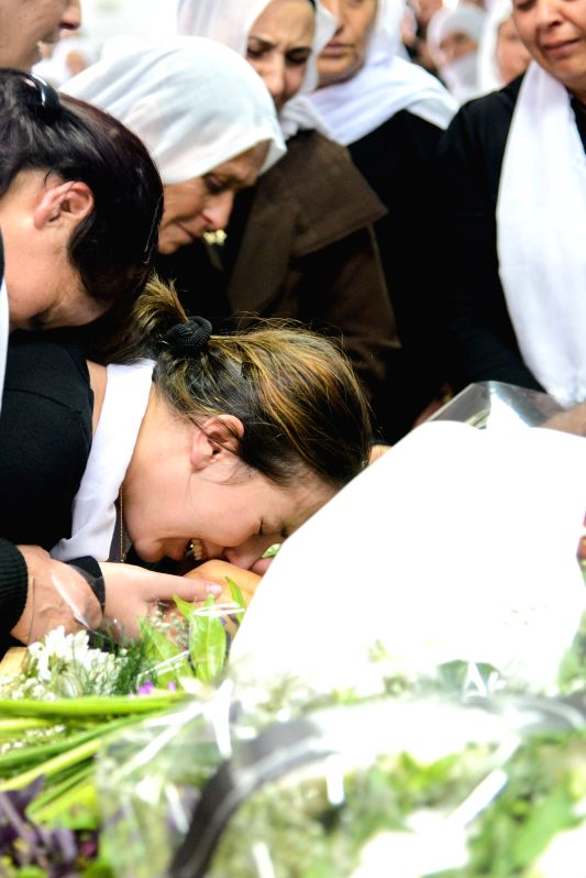 Friends and relatives mourn the death of Zidan Saief, a member of Israel's Druze minority, during his funeral in his northern home village of Yanuh-Jat, on Nov. 19, 2014. Saief died after .
