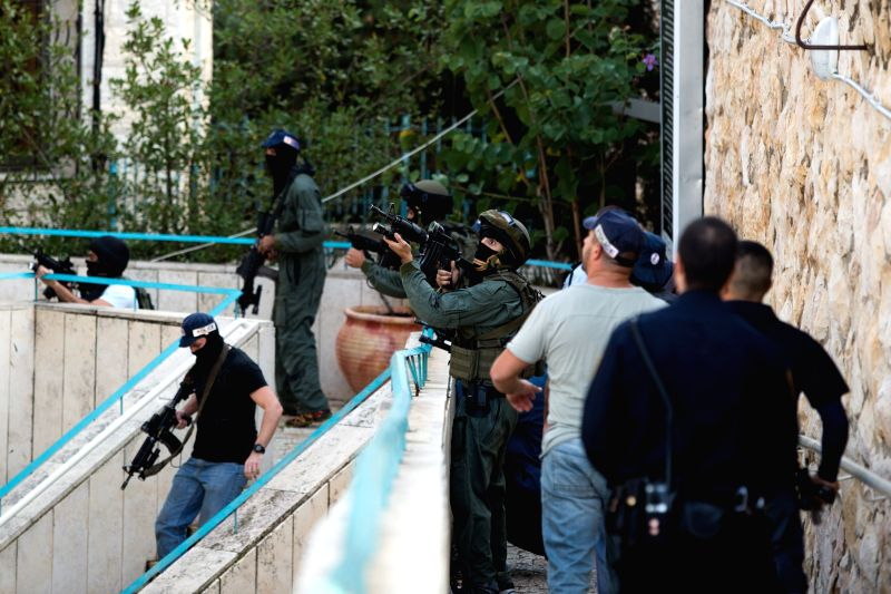 Jerusalem (Israel): Israeli police officers hold weapons near the scene of an attack at a synagogue in the Har Nof neighborhood of Jerusalem, on Nov. 18, 2014. A Palestinian left-wing group, the ...