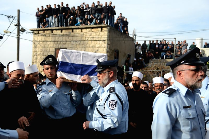 Israeli police officers carry the coffin of their comrade Zidan Saief, a member of Israel's Druze minority, during his funeral in his northern home village of Yanuh-Jat, on Nov. 19, 2014. .