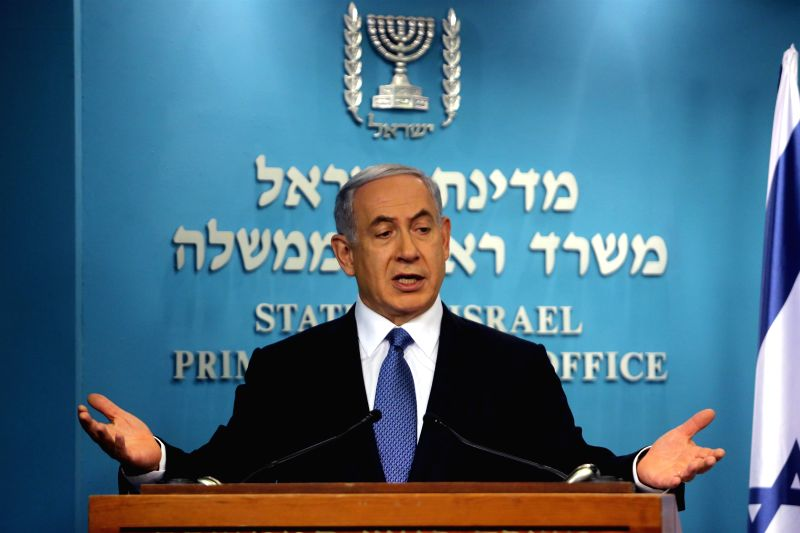 Israeli Prime Minister Benjamin Netanyahu addresses a news conference at the Prime Minister's office in Jerusalem, on Nov. 23, 2014. The Israeli cabinet on Sunday approved a controversial . - Benjamin Netanyahu