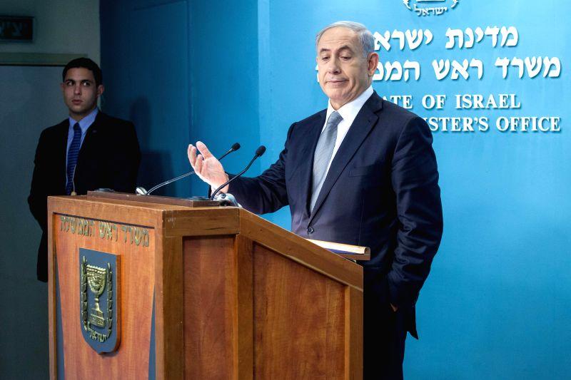 Israeli Prime Minister Benjamin Netanyahu addresses a press conference at the Prime Minister's office in Jerusalem, on Dec. 2, 2014. Israeli Prime Minister Benjamin Netanyahu announced his
