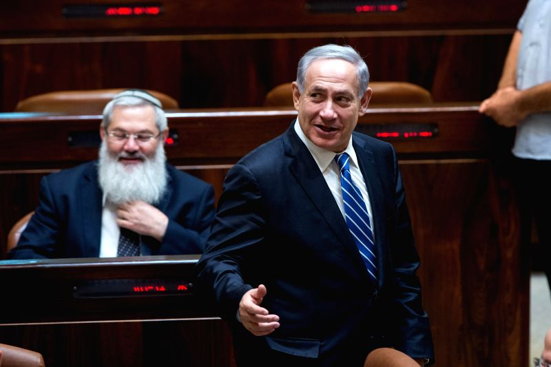 Israeli Prime Minister Benjamin Netanyahu (Front) attends a vote on a bill to dissolve the Knesset (parliament) at the Knesset in Jerusalem, on Dec. 8, 2014. Israeli politicians voted in .. - Benjamin Netanyahu