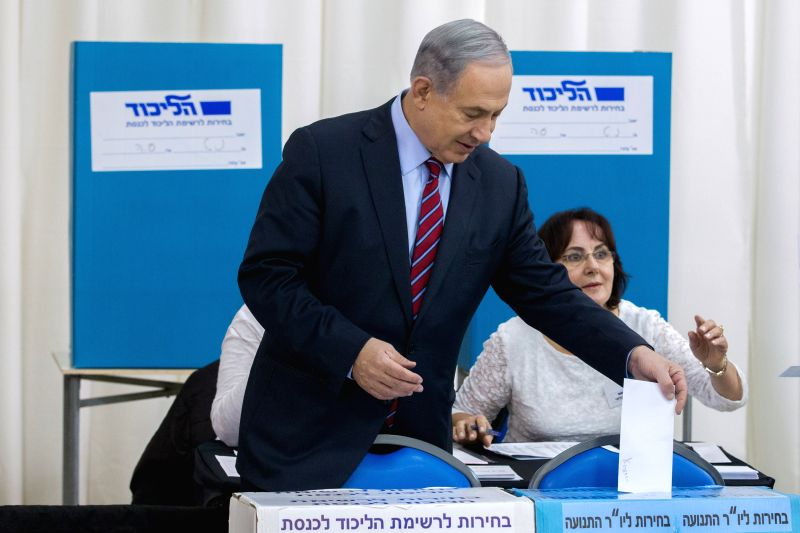 Israeli Prime Minister and head of the Likud party Benjamin Netanyahu casts his ballot as Likud opened the polls for its primary elections in Jerusalem, on Dec. ...