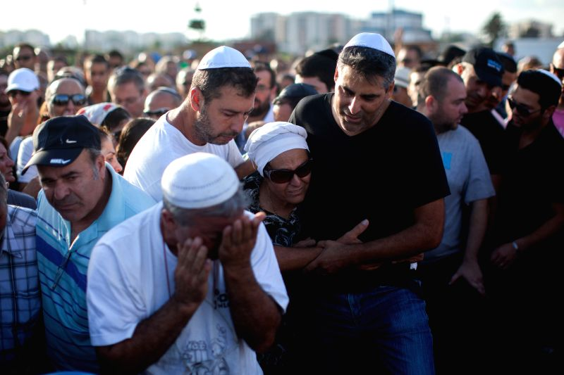 Relatives of the killed Israeli civilian Dror Hanin mourn during his funeral at a cemetery in Yahud, Israel, on July 16, 2014. Rocket fire from Gaza on Tuesday ...