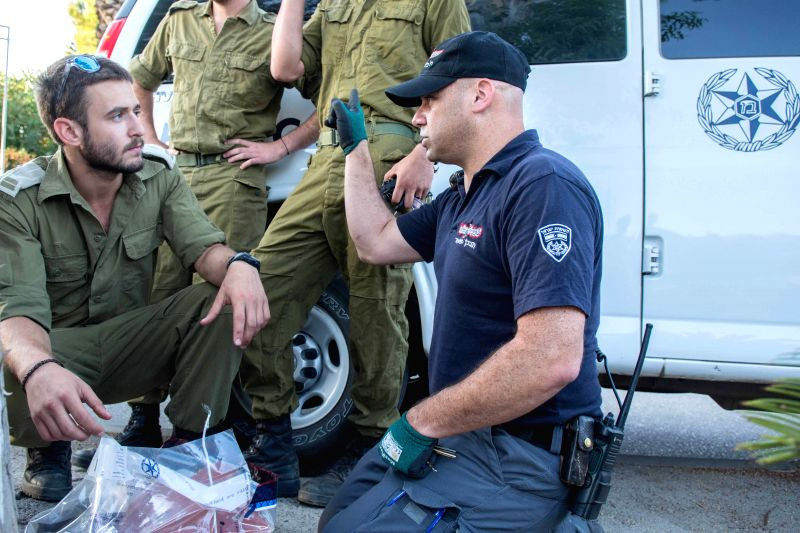 JERUSALEM, July 18, 2016 - Members of  Israeli security forces examine debris of Patriot air defense missiles in Ayelet Hashahar, northern Israel, on July 17, 2016. Israel launched two missiles in a ...
