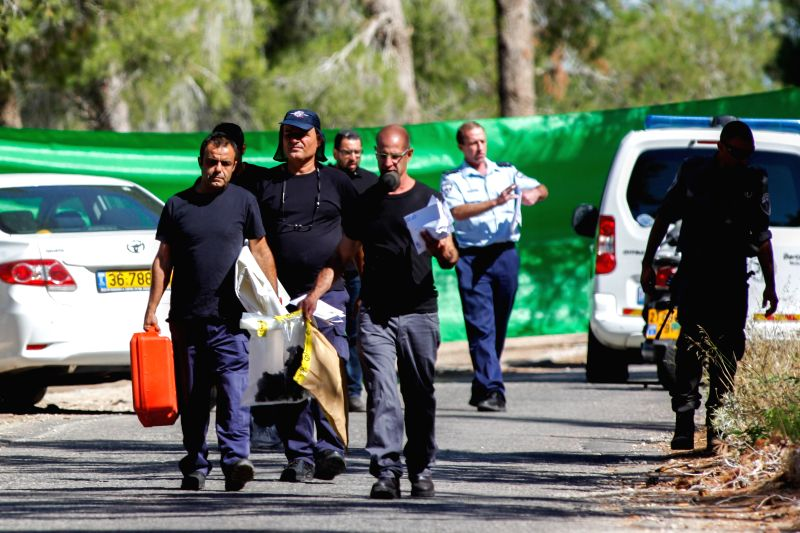 Investigators work near the crime scene where an Arab teen was found dead in the Jerusalem Forest, July 2, 2014. Early on Wednesday morning, police found a body of