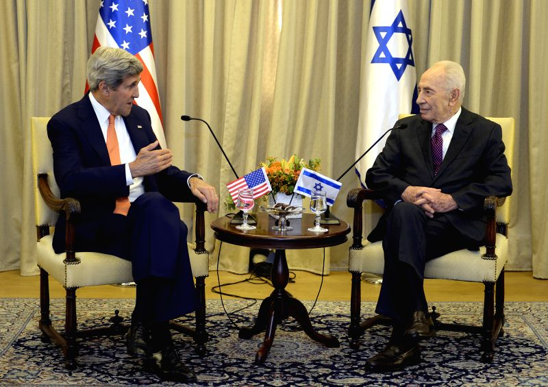 Israeli President Shimon Peres(R) meets with visiting U.S. Secretary of State John Kerry at President's Residence in Jerusalem, on July 23, 2014. John Kerry ...