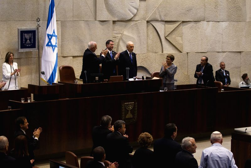 Outgoing Israeli President Shimon Peres (C, Rear) receives respects during Reuven Rivlin's  (2nd L, Rear) swearing-in ceremony at the Knesset