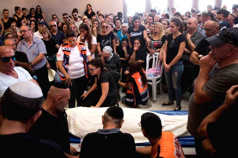 JERUSALEM, July 27, 2018 - Family members and friends mourn at the funeral of Yotam Ovadia at the Har Hamenuchot cemetery in Jerusalem, on July 27, 2018. Yotam Ovadia, a 31-year-old Israeli man, died ...