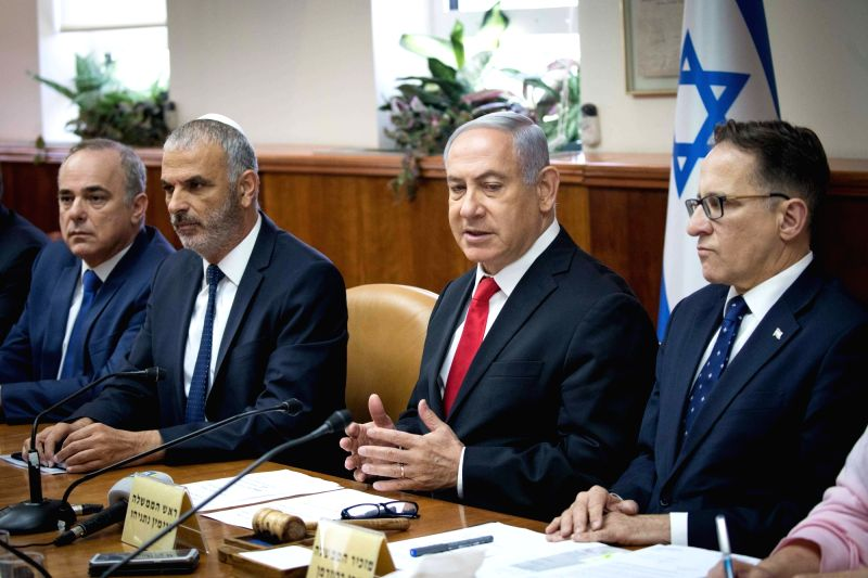 JERUSALEM, June 10, 2018 - Israeli Prime Minister Benjamin Netanyahu (2nd R) chairs the weekly cabinet meeting in Jerusalem, on June 10, 2018. Benjamin Netanyahu said Sunday that European leaders ... - Benjamin Netanyahu
