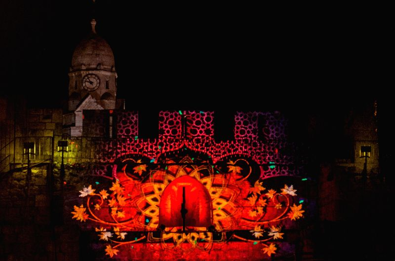 An audiovisual show projected on the wall of Armenian Patriarchate St. is seen at Armenian Quarter in the Old City of Jerusalem, on June 19, 2014. The sixth ...