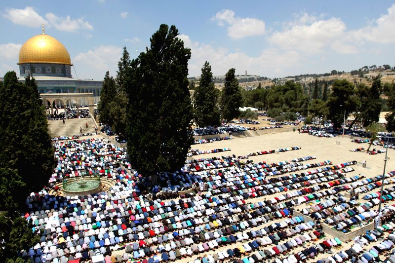 JERUSALEM, June 3, 2017 - Muslim worshippers attend the first Friday prayer of the Muslim holy month of Ramadan outside the Dome of the Rock at Jerusalem's al-Aqsa mosque compound on June 2, 2017.