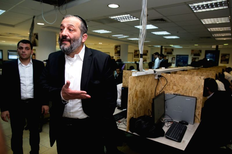 "Leader of Israel's ""Shas"" Party Aryeh Deri (front) reacts at the ""Shas"" Party headquarters in Jerusalem, on March 16, 2015, one day before ..."