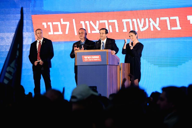 Israel's Zionist Union's leader Isaac Herzog (2nd R) thanks supporters after the exit polls' results came out at the Zionist Union campaign headquarters in Tel ... - Benjamin Netanyahu