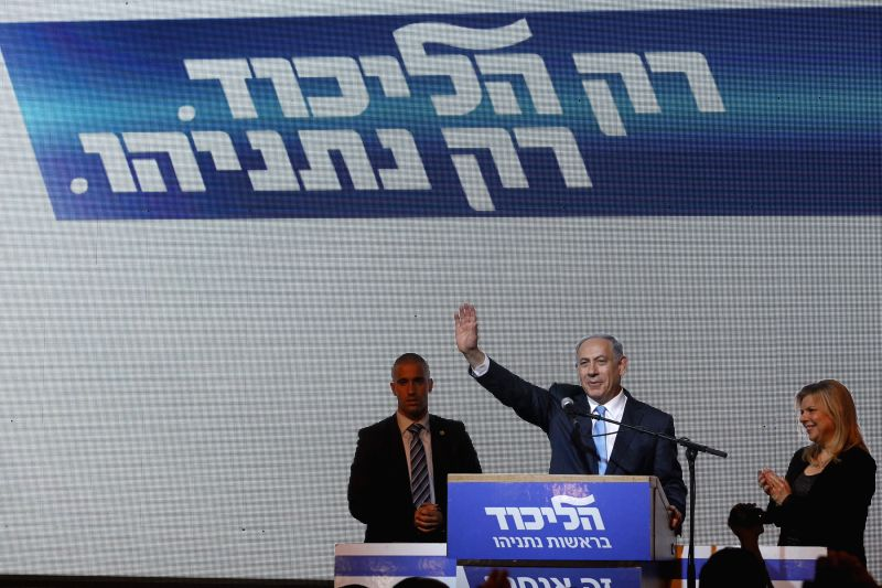 Israeli Prime Minister and Likud Party leader Benjamin Netanyahu (2nd R) waves to supporters with his wife Sara (1st R) at Likud Party campaign headquarters in ... - Benjamin Netanyahu