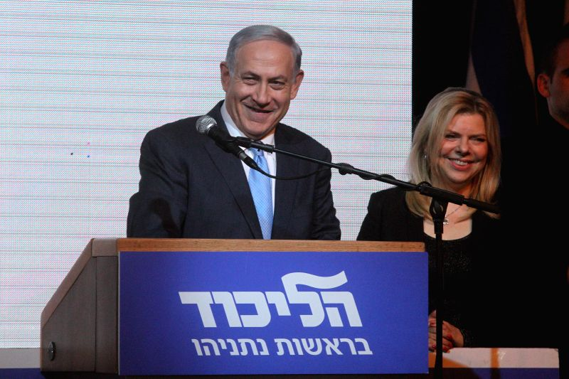 Israeli Prime Minister and Likud Party leader Benjamin Netanyahu (L) thanks supporters at Likud Party campaign headquarters in Tel Aviv, Israel, on March 18, ... - Benjamin Netanyahu