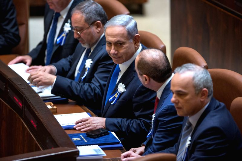 Israeli Prime Minister Benjamin Netanyahu (3rd R) attends the swearing-in ceremony at the Knesset (Israeli parliament) in Jerusalem, on March 31, 2015. Israel's ... - Benjamin Netanyahu