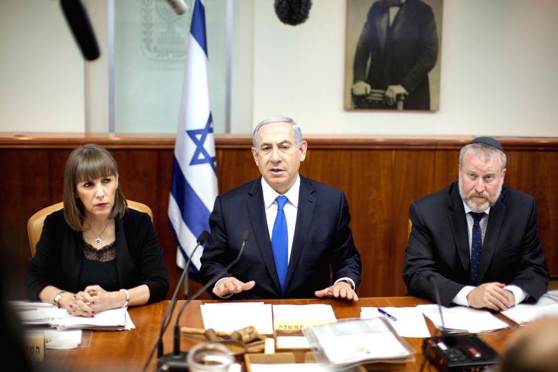 Israeli Prime Minister Benjamin Netanyahu (C) chairs the weekly cabinet meeting at his office in Jerusalem, on March 8, 2015. Netanyahu announced on Sunday that ... - Benjamin Netanyahu