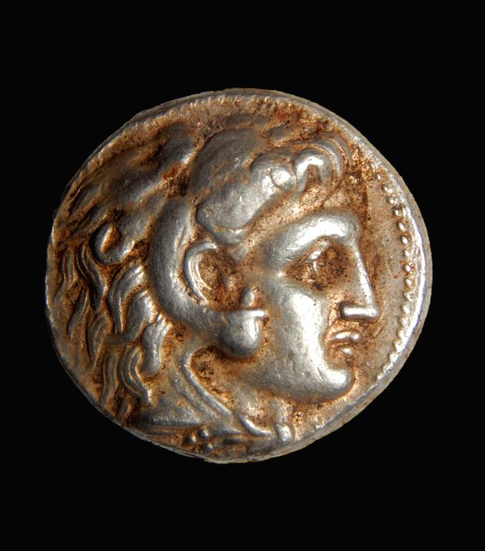 Undated photograph released by Israel Antiquities Authority shows a coin of Alexander of Macedon that was part of the silver cache. Rare coins and jewelry from ...