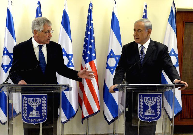 Israeli Prime Minister Benjamin Netanyahu (R) and visiting U.S. Secretary of Defense Chuck Hagel attend a press conference at the Prime Minister's Office in ... - Benjamin Netanyahu