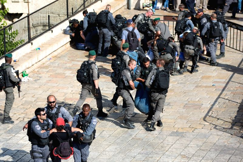 "JERUSALEM, May 25, 2017 - Israeli policemen take protesters away from Damascus Gate of Jerusalem's Old City before an Israel's ""Jerusalem Day"" celebration on May 24, 2017. Tens of thousands ..."