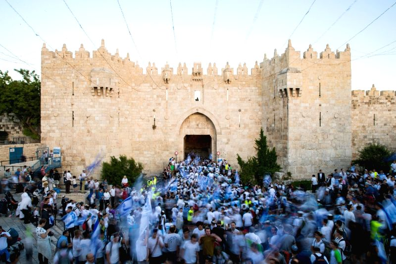 "JERUSALEM, May 25, 2017 - Israelis march into Damascus Gate of Jerusalem's Old City during a celebration of Israel's ""Jerusalem Day"" on May 24, 2017. Tens of thousands of Israelis marched ..."