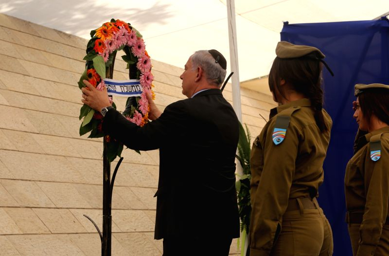 Israeli Prime Minister Benjamin Netanyahu (1st L) lays a wreath to commemorate fallen soldiers during a ceremony marking Remembrance Day at Yad Lebanim in ... - Benjamin Netanyahu