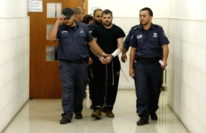 JERUSALEM, May 4, 2016 - Yosef Ben David (C), who was convicted last month of murdering the 16-year-old Palestinian teenager Mohammed Abu Khudair in Jerusalem, is led into a courtroom to hear his ...