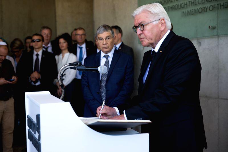 JERUSALEM, May 7, 2017 - German President Frank-Walter Steinmeier (R) signs the guest book at Yad Vashem Holocaust Memorial in Jerusalem, May 7, 2017.